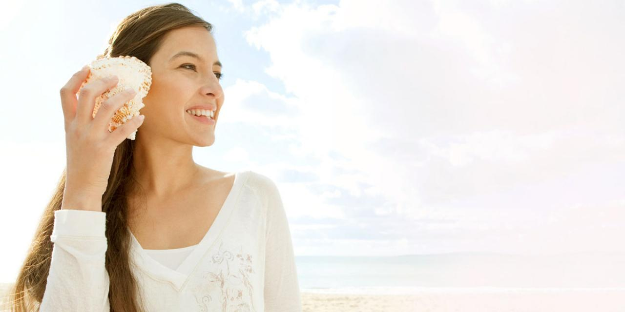 shutterstock 145911800 WOMAN SHELL BEACH sized 1280 x 600